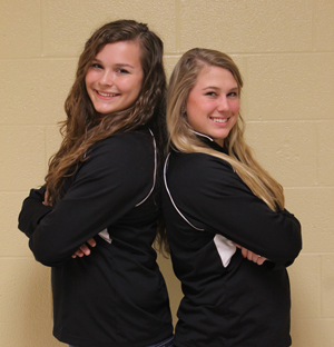 Two senior soccer players continue to play together