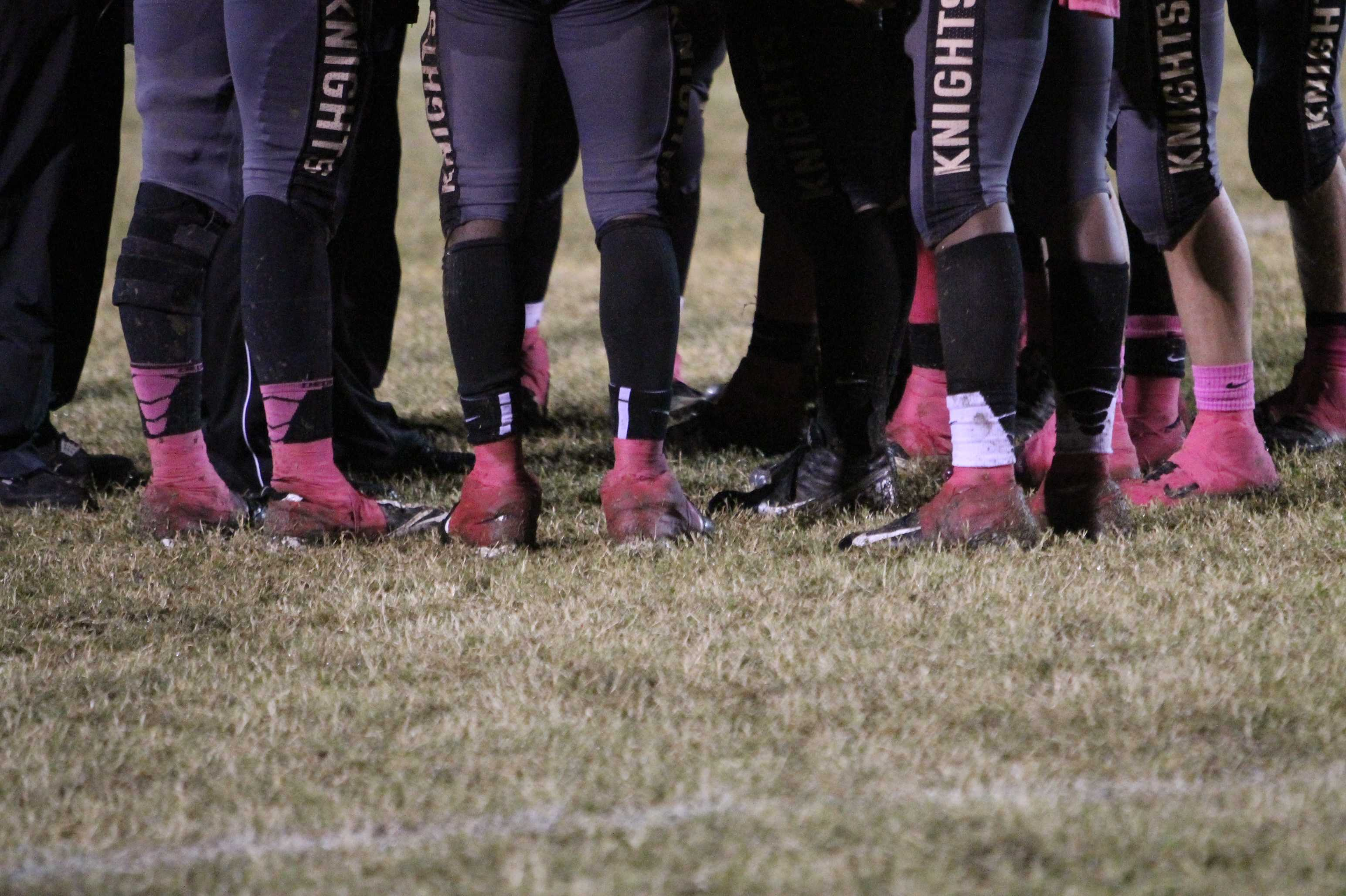 Varsity football teams sports their pink socks in support of breast cancer awareness at annual Pink Out game October 5, 2012.