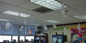 Student-created snowflakes hang from the ceiling of room 217.