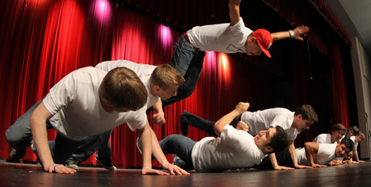 Last year's Mr. FHN contestants participate in the group dance. At the beginning of the event, all of the boys perform a group dance. This year, the dance will be sport themed. (file photo)