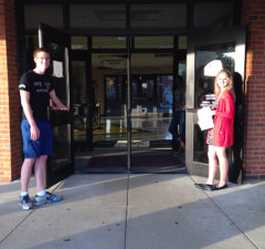 Communications Officer Elise Gertsch greets students on Friendly Friday. (photo by sammie savala)