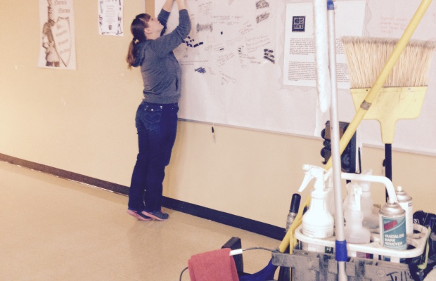 Tessa Smith working on hanging up everyones pledge to be apart of our no place for hate school.