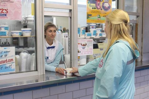 Dagenais hands the custard to the customer. According to Dagenais, Fritz's isn't very busy until school gets out because all of the seating is outdoors.