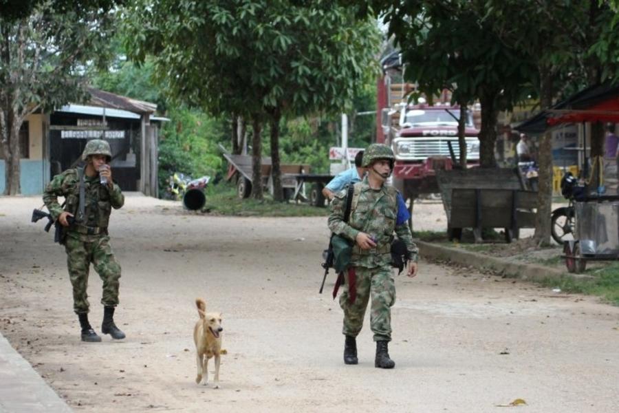 Two Colombian soldiers survey a village (Photo: Vlad Galenko, Shutterstock)