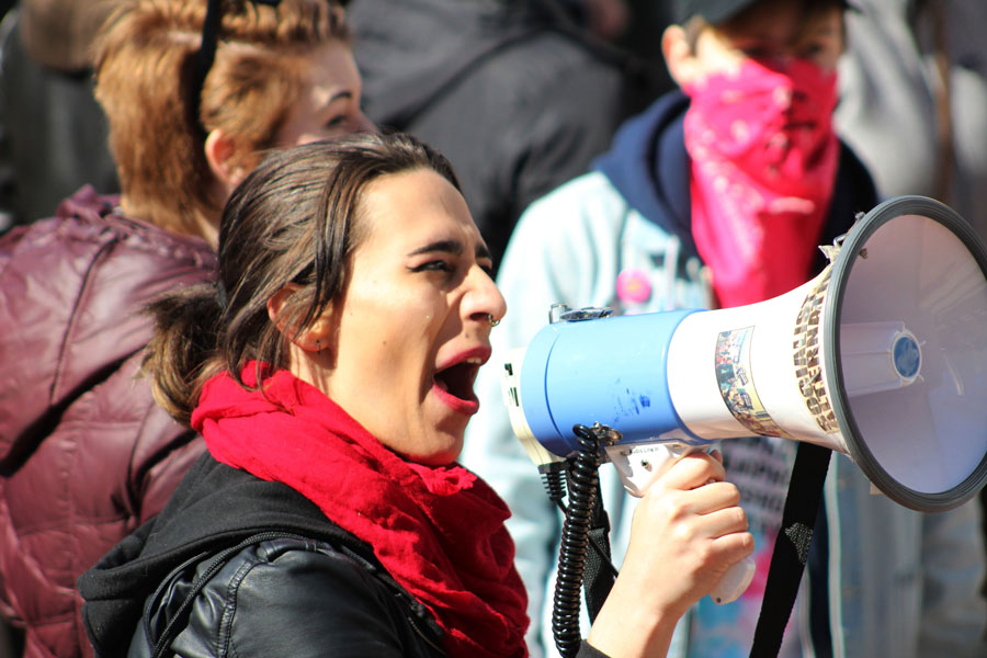 A protester yells through a megaphone in front of the courthouse. Multiple people carried megaphones and lead the crowds in various chants.