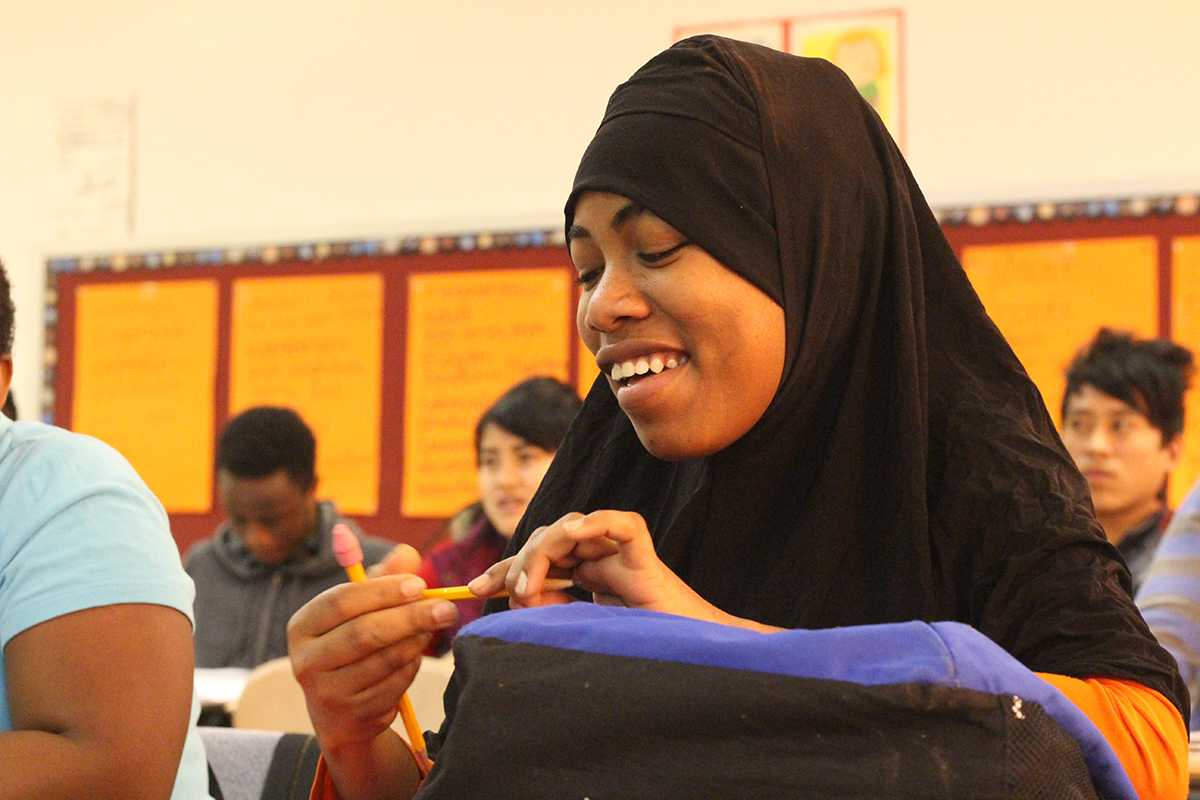 A 9th grade student at the Nahed Chapman Academy smiles after getting an answer correct. Students come into the Nahed Chapman New American Academy at various levels. They get to attend the school for two years, or until they can adapt successfully into American society. Some students have no concept of numbers when they first get to the school, but the staff is able to get the students where they want to be.