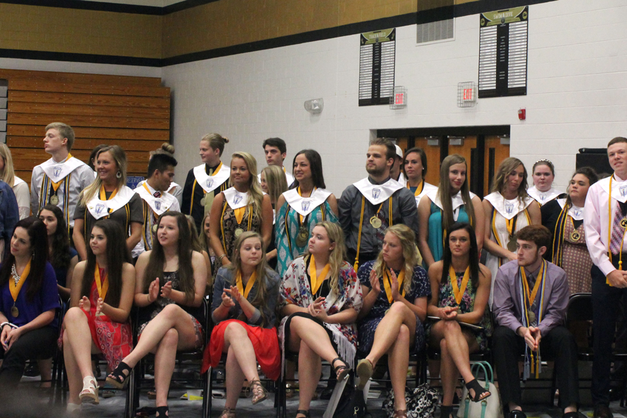 The NHS members in the senior class of 2016 stand at Senior Awards Night.