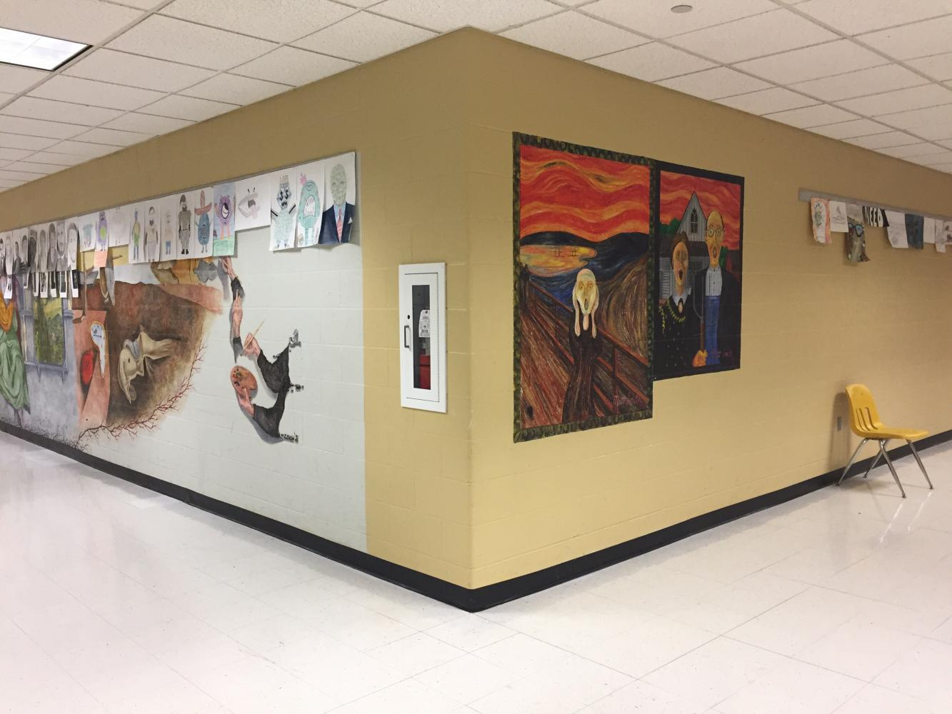 In the art hallway, murals have been added to be showcased along students artwork.