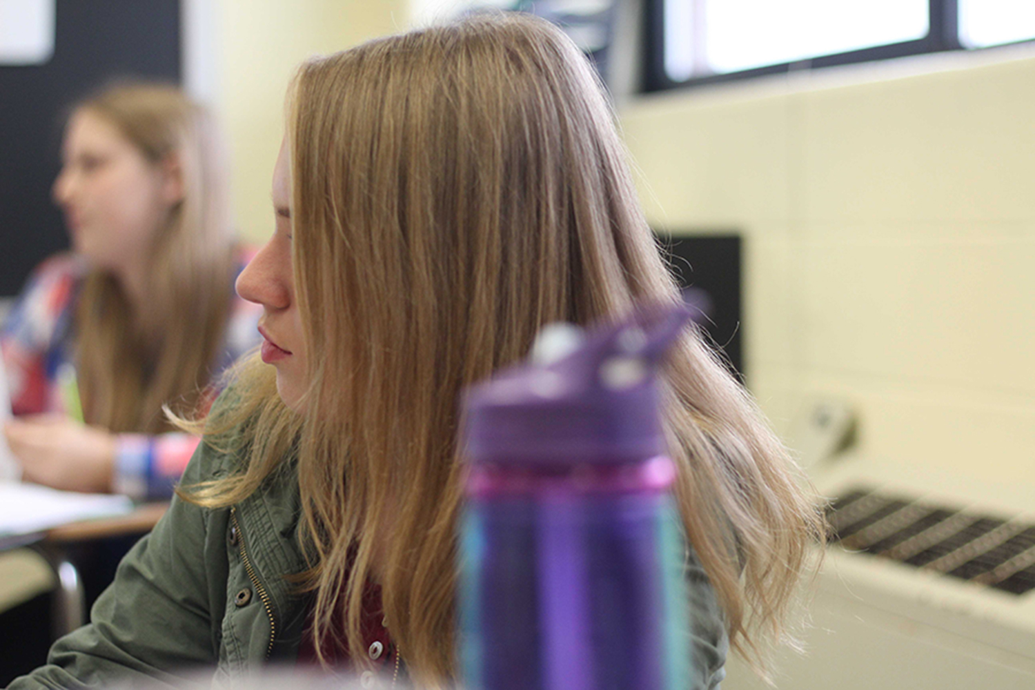 """Junior Kira Stock does class work in AP Language. The class is taught by Jani Wilkens. They were working on a satire piece by Ed Yeems titled """"Live Every Day as if You're Dying of a Contagious Disease that Turns people You Bite into Zombies."""""""