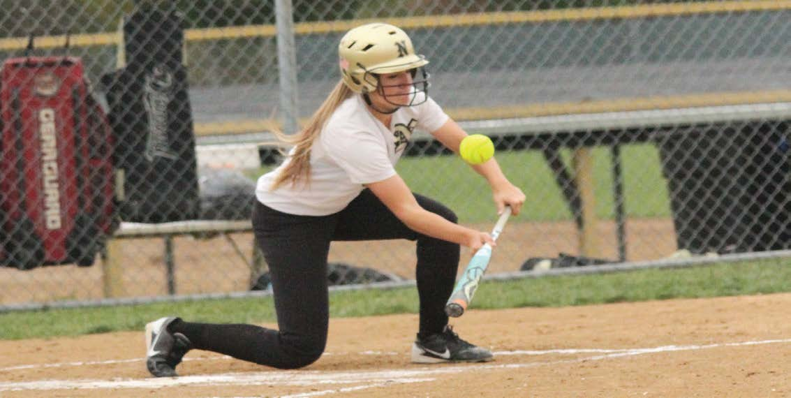 Junior Jessica Grimes, bunts the ball in a game against Hazelwood Central on Oct. 1. The Knights pulled a 9 to 4 victory during the Varsity team's Senior Night. (zack eaton)