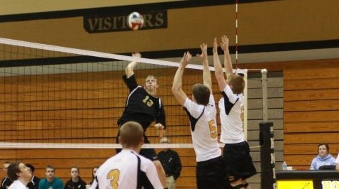 Collin Toedtmann spikes the ball through the block made the FZE players.