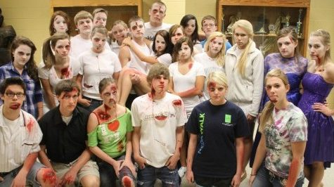 Students participating in last year's simulation gather around before showcasing the effect of drunk-driving accidents that occur in a single school day. (File Photo)