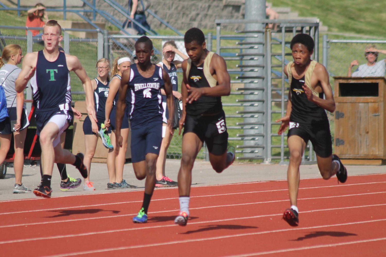 Runners+finish+100m+dash
