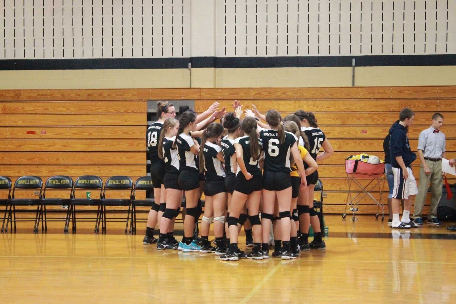 The freshmen volleyball girls huddle together before they start their game against Francis Howell Central.