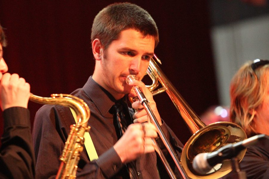 Alum Mike Lindsey performs his trombone during the winter concert. Lindsey was one of seven students to make All State Band.