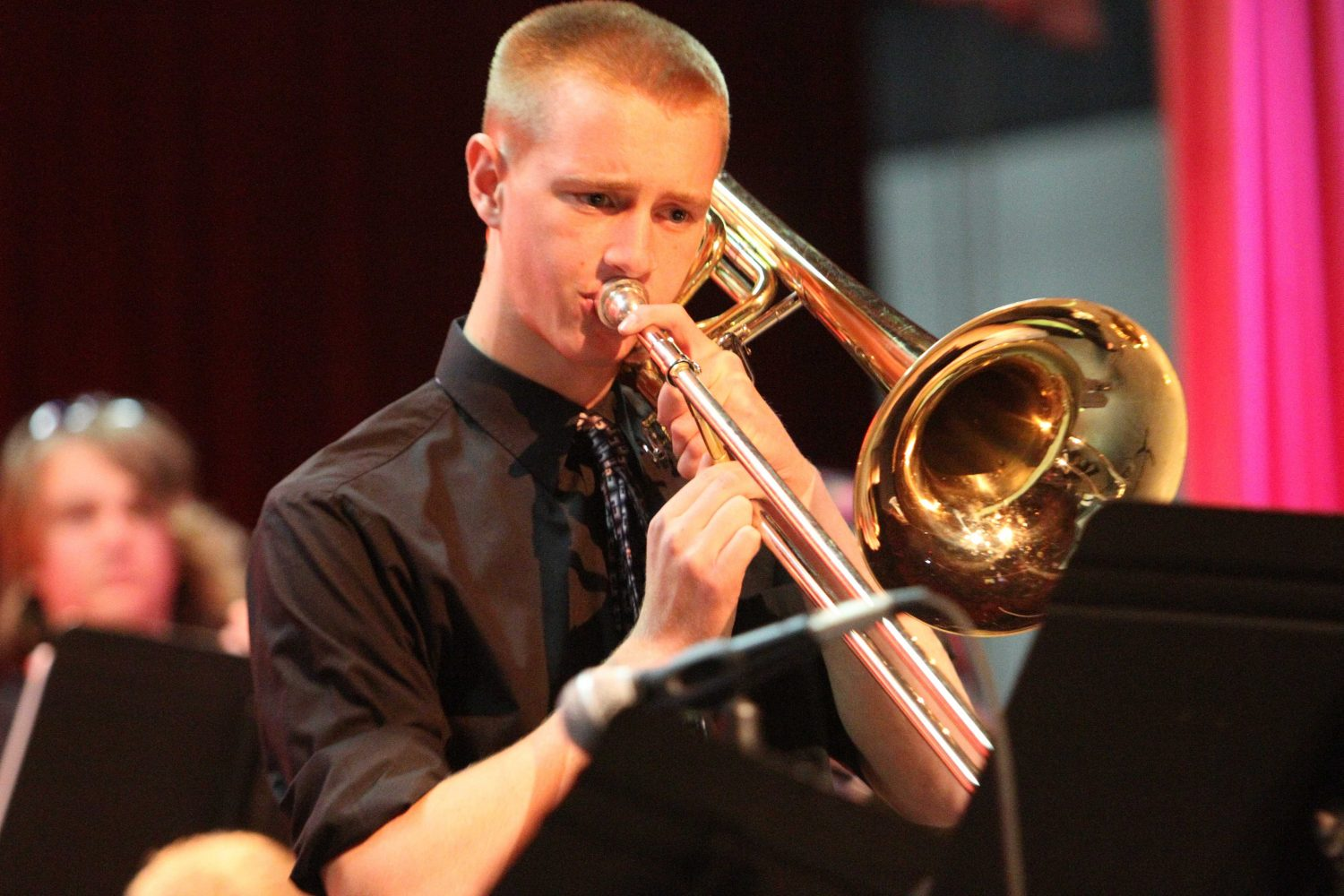 Band student plays his trombone on stage during a previous winter concert.