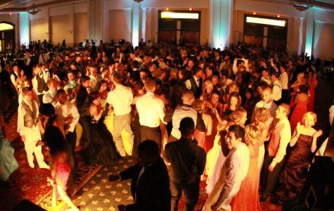 Students dance together at prom, themed