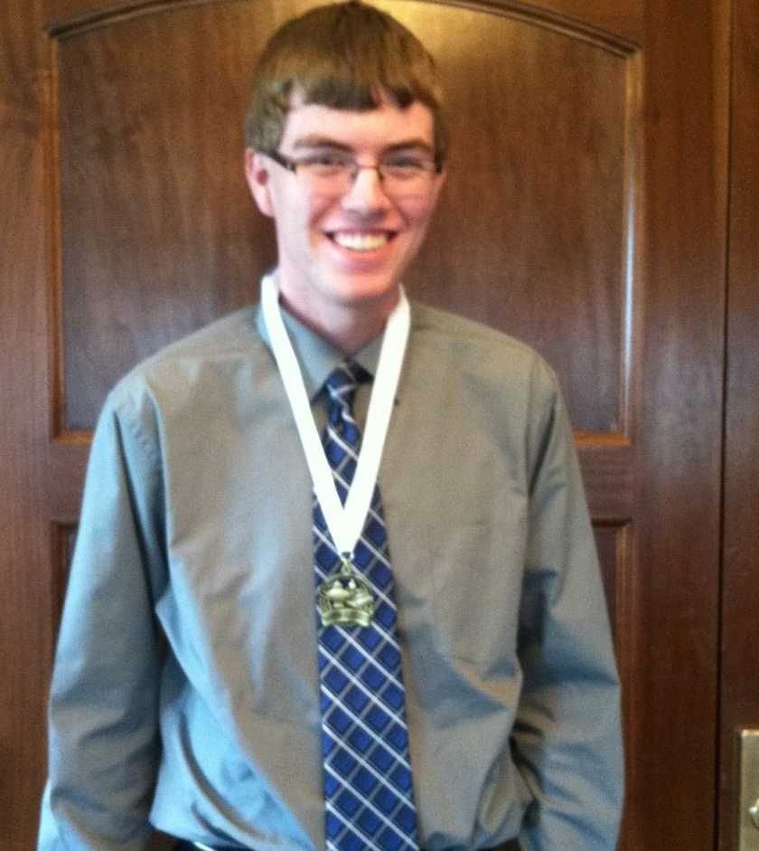 Nathan Rhomberg at last years luncheon wearing his medal after the ceremony. (Photo by Chelsie Hollis)