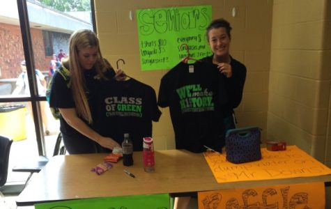 seniors Emma Cleaveland and Marykate Feldhaus selling senior apparel during lunches