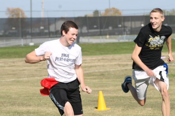 NHS members play flag football for charity in October. NHS members must take part in community service hours as part of the requirements of membership. (file photo)