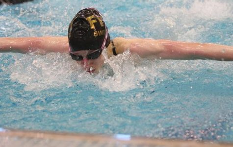 Freshman Erin Stock competes in the 100 yard butterfly. Stock got 3rd place at the GAC finals on Thursday Feb. 12. Stock will continue on to state at the Rec Plex on tba