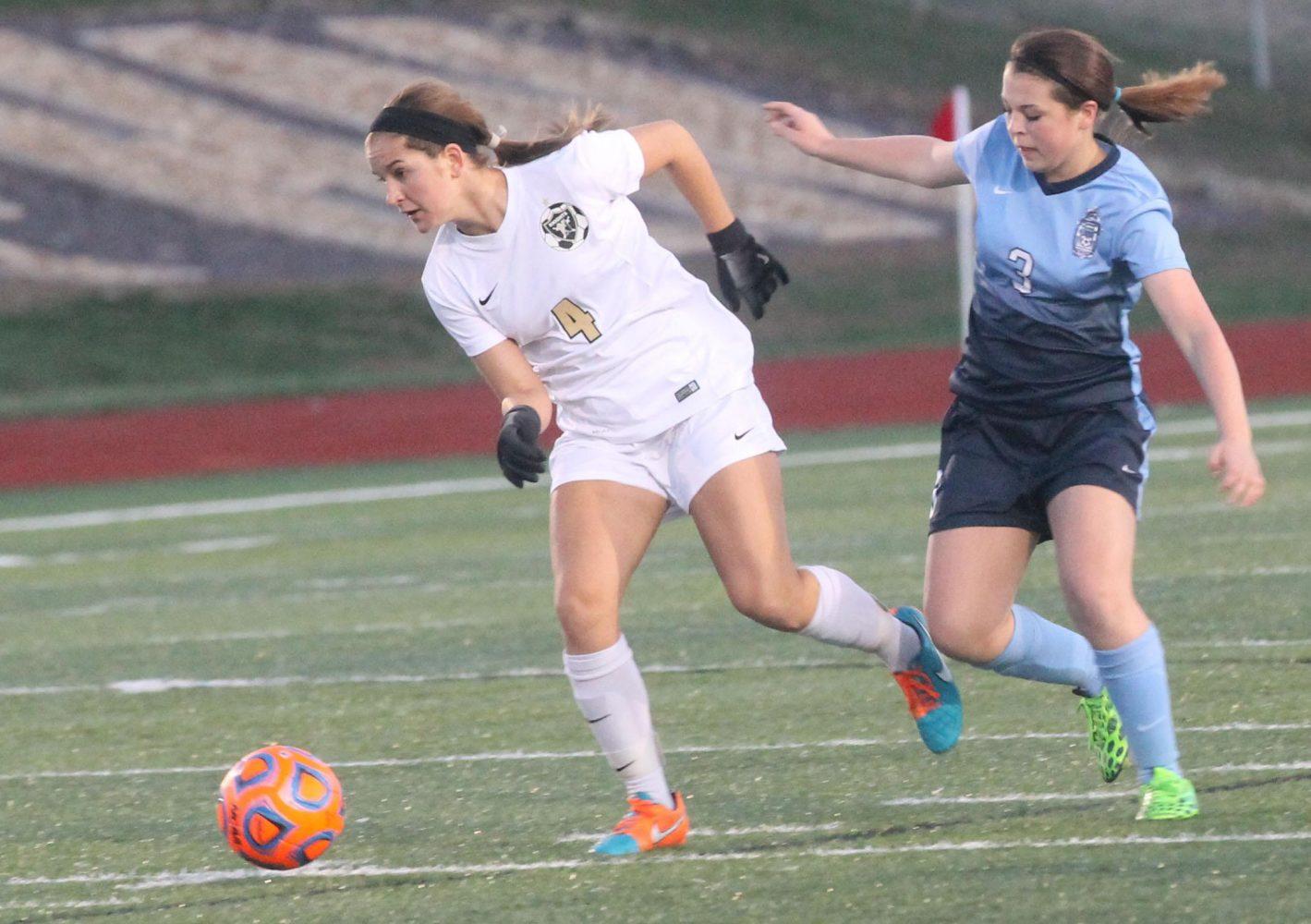 Sophomore Amanda Orlando runs with the ball towards the goal.