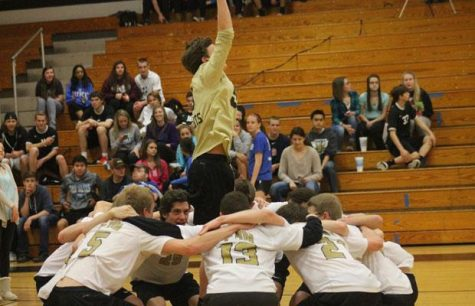 Junior Jake Oppenborn pumps up the boys volleyball team before a game.