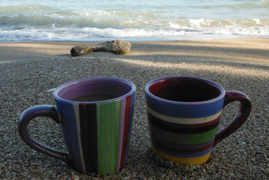 Two coffee mugs rest in the sand on a beach in the northern part of Puerto Rico. Tropical destinations such as Puerto Rico are popular with not only FHN students, but others around the world.