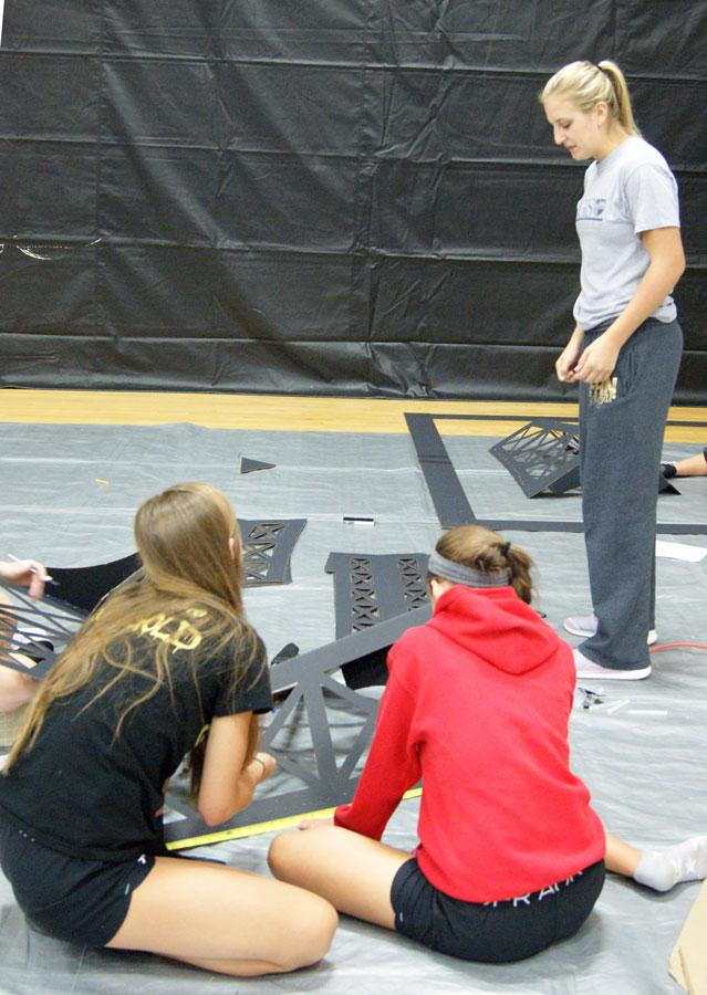 Nicole Morse supervises the 2015 Homecoming preparations. At this years Homecoming dance STUCCO members came together to make a spectacular dance floor with this years theme