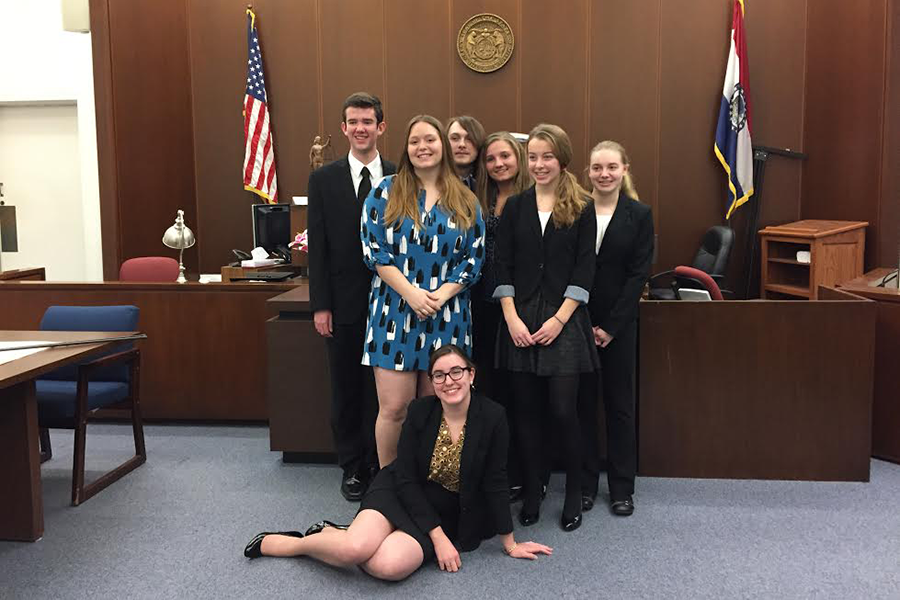 Members of one of the FHN mock trial teams stands in a court room after having won one of their preliminary trials. They will attend state in Kansas City at the beginning of April. (Submitted photo)