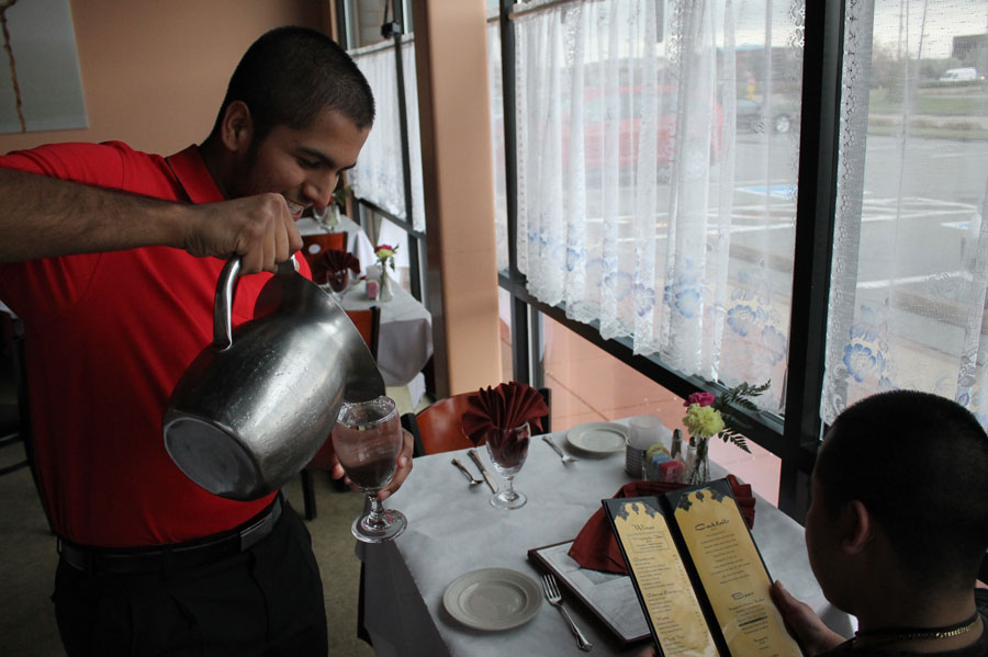 Sohail pours water for a customer. The Taj Palace has a lunch buffet from 11:30 am to 2:15 pm everyday. The dinner service on Monday thru Thursday is 5:00 PM to 8:30 pm for dining in and carry out is until 9:00 pm. Friday thru Saturday dinner service is from 5:00 pm to 9:30 pm and carry out is until 10:00 pm.