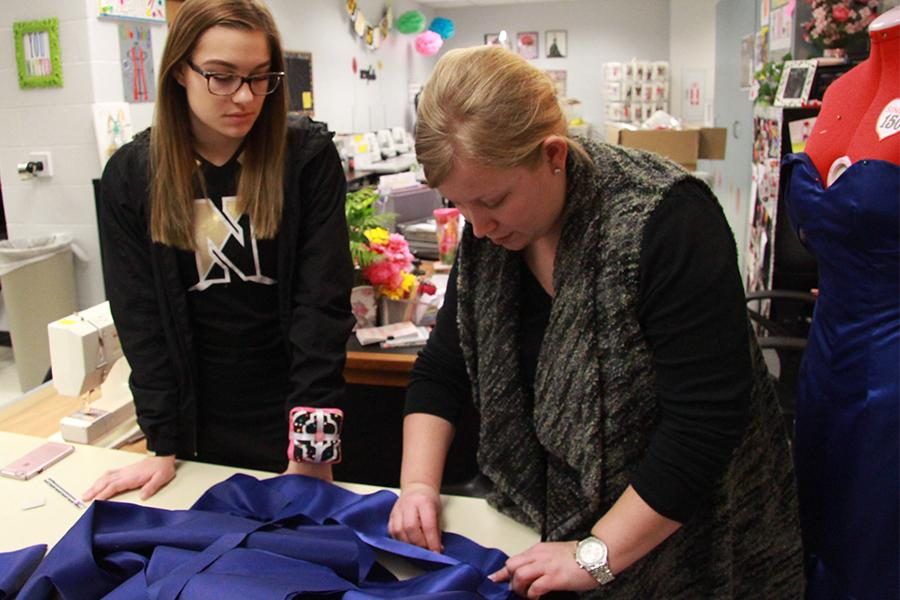 Senior Abby Day talks to FACS teacher Marissa Cohen about pleating the sleeves of her prom dress. Day is making her dress for a project in Advanced Clothing II. Day is planning to make the sleeves of her prom dress hanging off of her shoulders.