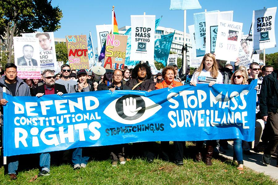 WASHINGTON - OCTOBER 26: Protesters rally against mass surveillance during an event organized by the group Stop Watching Us in Washington, DC on October 26, 2013. (Rena Schild / Shutterstock.com)