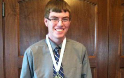 Nathan Rhomberg at the 2014 luncheon wearing his medal after the ceremony. (Photo by Chelsie Hollis)