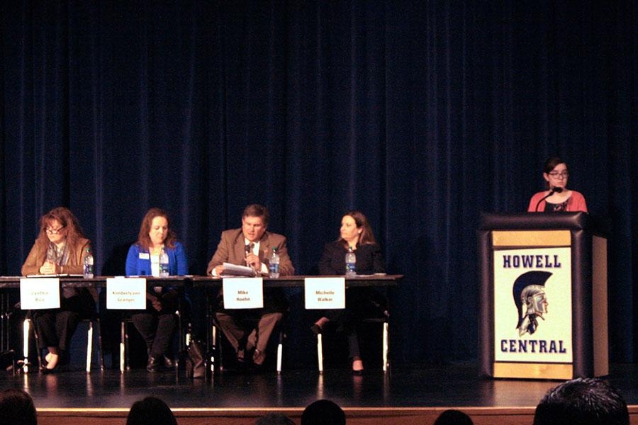 The candidates for school board, Cynthia Bice, Kimberlyann Granger, Mike Hoehn and Michelle Walker sit on stage at Francis Howell Central for meet the candidates night. This night gave parents the opportunity to see how the candidates would act on the school board before the election. The election was on April 5.