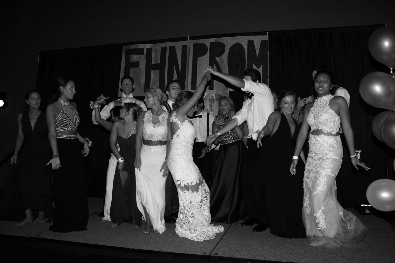 Senior Anna Chowning dances with her date Mitch Carlson at prom. Prom was held at Saint Charles Convention Center with fairytale themed decor.