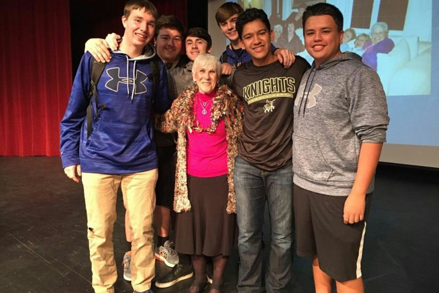 Students+stand+with+Holocaust+survivor+Rachel+Miller+after+her+presentation+in+2016.+She+will+speak+to+sophomore+English+classes+again+on+Nov.+28.+%28photo+submitted%29