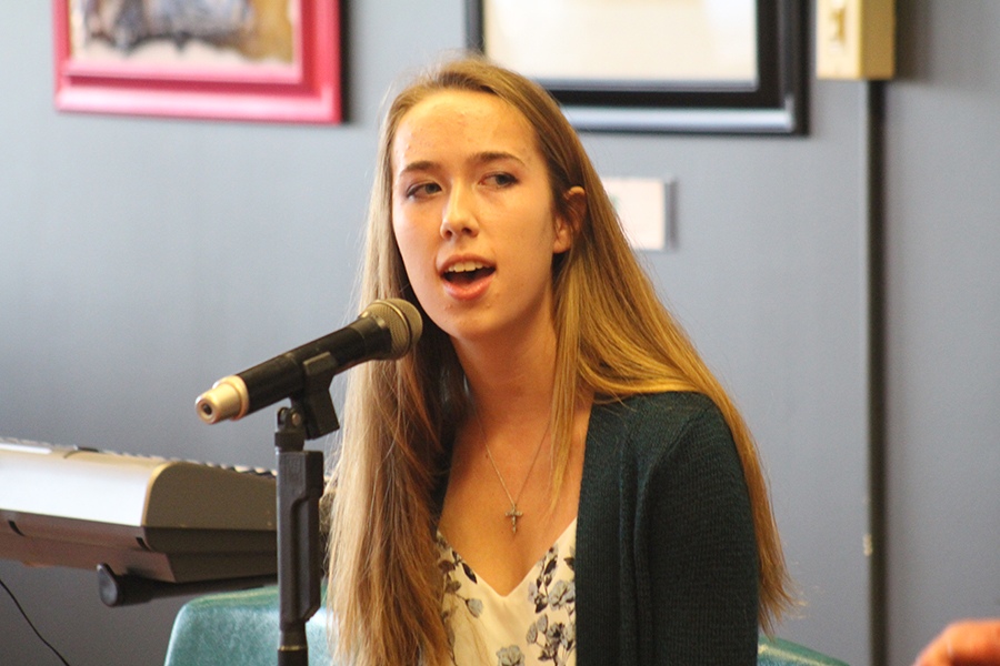 Senior Amy Wedewer sings in front of the Coffeehouse Day One audience. The Coffeehouse is an annual event hosted by the FHN Learning Commons.