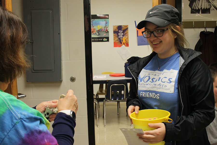 FHN junior Brooke Williams collects hat day money for the Schwartz family.