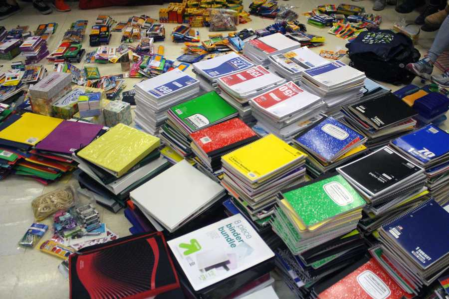 2,230 school supplies items sit on the floor in the publications room after staffers sorted them out. The school supplies were collected through a drive in all first hours. All the proceeds will benefit the Nahed Chapman New American Academy near downtown St. Louis.