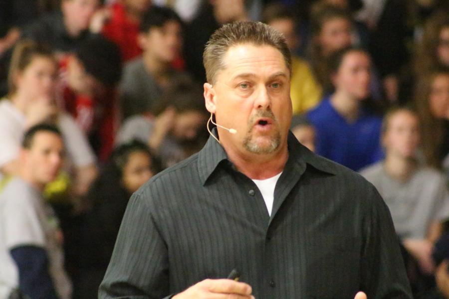 """Joe Richardson, a co-founder of The Awaken Project, stands in front of the FHN student body to tell his story of drug addiction in his family, and the effect it can have on others. The father of two daughters lost his son, an FHN alumni, to heroin on Aug. 12, 2012. """"It's therapy for me to do this,"""" Richardson said. """"Somebody's got to do this."""""""