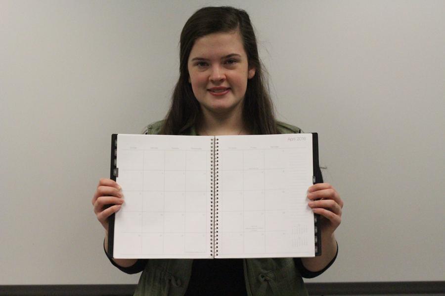 Senior Laraya Griffith poses with a calendar. (Photo by Alex Rowe)