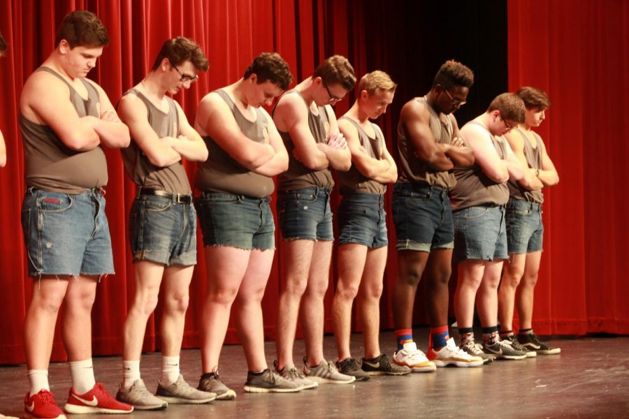 Mr. FHN contestants lineup before their opening dance number, crossing their arms and bowing their heads. The Mr. FHN contestants danced to a mashup of songs that included