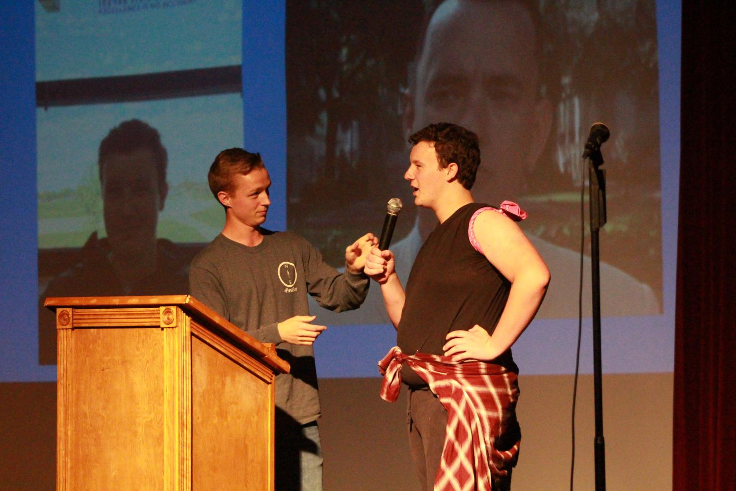 "Senior Anthony Kristensen  and Junior Christian Witte talk on stage during Kristensen's slideshow performance. His slideshow started off with many ""teacher lookalikes"" around FHN, comparing them to actors and even movie characters. He then moved onto comparing the other Mr. FHN contestants and even himself to other people."