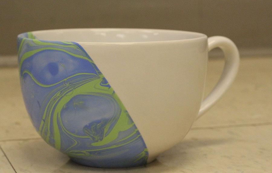 A finished mug sits on a table.