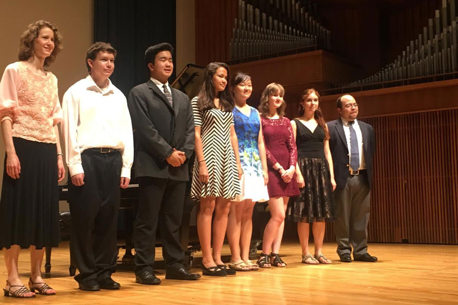 Junior Colin Levins stands on stage with his fellow students after a recital held at Penn State over the summer. Levins attended a camp there last July for seven days. (photo submitted)
