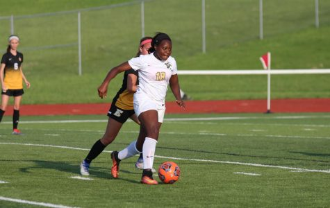 Sophomore Bria Hamilton brings the ball down the field in the Lady Knights' Senior Night match against FZE (Kyra Peper)