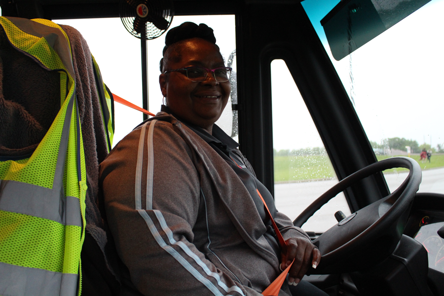 Robin Hamlin sits behind the wheel of D4 outside FHN after dropping off the students she transports to and from FHN.