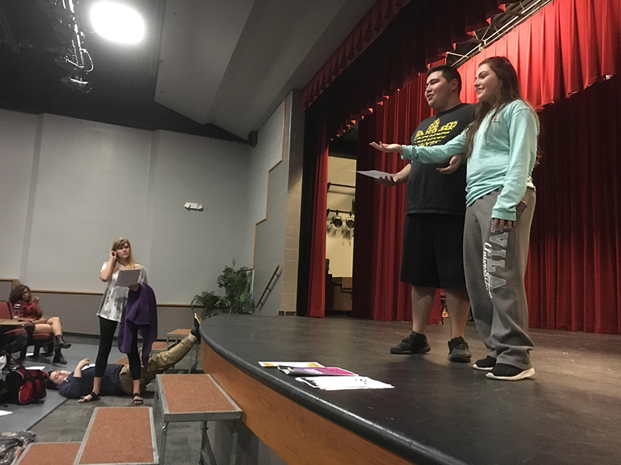 Emcee's Bria Smith and Brian Ochoa rehearse for tomorrows performance, as co-student director Sydney Weber looks on.