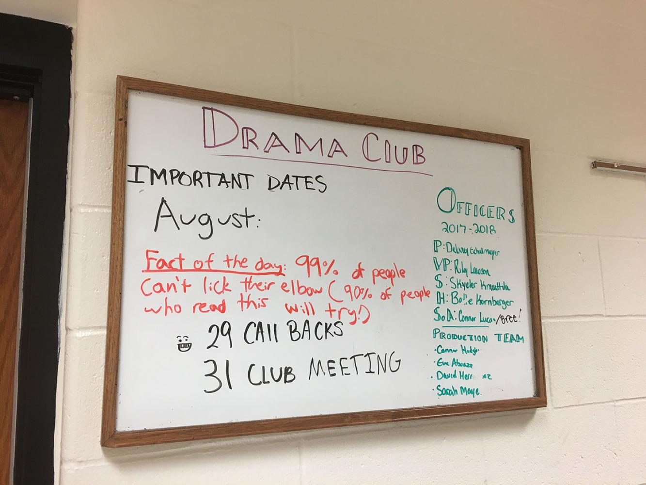 Drama+Club+President+Delaney+Echelmeyer%2C+finishes+the+Drama+Club+announcement+board+with+new+announcements+for+the+day.